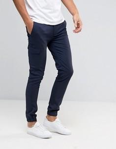 Супероблегающие джоггеры в строгом стиле с карманами ASOS - Темно-синий