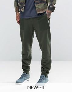 Суженные книзу спортивные штаны цвета хаки с принтом на карманах ASOS - Зеленый