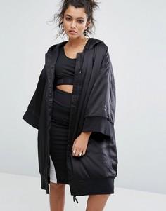 Свободная дутая куртка с капюшоном Puma - Черный