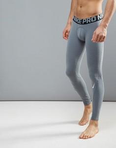 Серые спортивные компрессионные колготки Nike Pro Warm 725039-065 - Серый