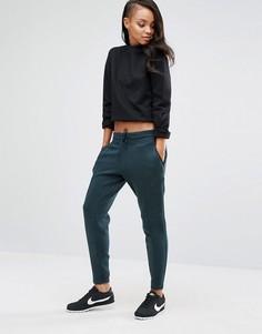 Зеленые трикотажные штаны Nike Premium - Серый