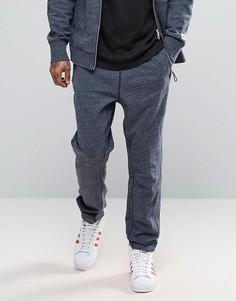Джоггеры скинни adidas x Reigning Champ BS0630 - Темно-синий