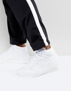 Белые кроссовки средней высоты Nike Air Jordan 1 554724-104 - Белый