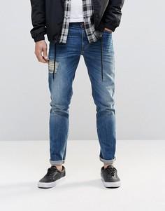 Синие зауженные джинсы с прорехами спереди и сзади ASOS - Синий