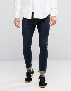 Зауженные джинсы цвета индиго с контрастными строчками Levis 519 - Темно-синий