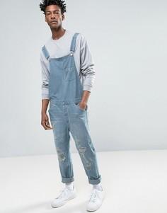 Светлый джинсовый комбинезон в винтажном стиле с прорехами ASOS - Синий