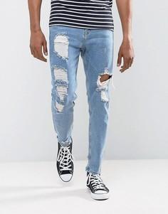 Голубые суженные книзу джинсы с рваной отделкой ASOS - Синий