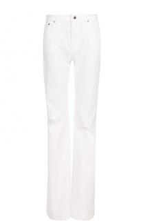 Расклешенные джинсы с потертостями Roberto Cavalli