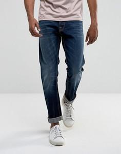 Свободные суженные книзу джинсы цвета индиго Nudie Jeans Co Fearless Freddie - Темно-синий