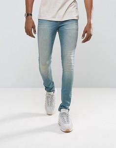 Выбеленные супероблегающие джинсы ASOS - Синий