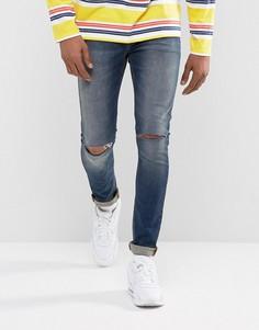 Темно-синие супероблегающие джинсы с рваной отделкой из ткани плотностью 12,5 унций ASOS - Синий