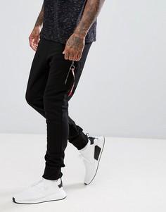 Черные узкие трикотажные брюки карго Alpha Industries X-Fit - Черный