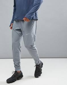Серые тканые брюки Nike Running Flex 885280-065 - Серый
