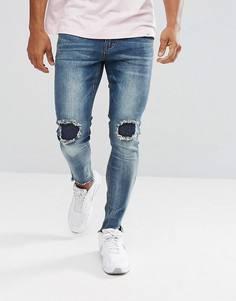 Выбеленные джинсы скинни с рваной отделкой boohooMAN - Синий