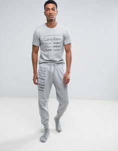 Узкие джоггеры с манжетами и логотипом Calvin Klein - Серый