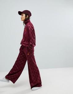 Широкие спортивные штаны в клетку Ellesse - Красный
