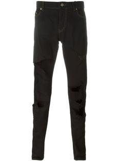 джинсы кроя слим  с рваными деталями   Saint Laurent