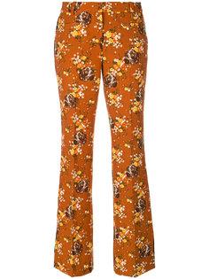 расклешенные брюки с цветочным узором Coach