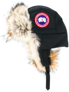 шапка-ушанка с отделкой из меха койота  Canada Goose