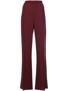 брюки с заклепками и складками  Area