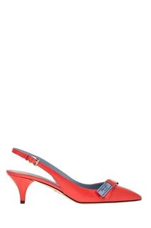 Красные туфли с логотипом Prada