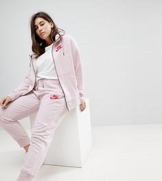 Розовые спортивные штаны с манжетами Nike Plus Rally - Розовый