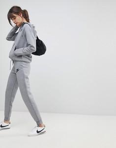 Серые спортивные штаны узкого кроя Nike Rally - Серый
