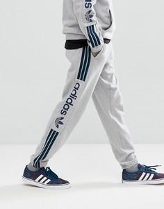 Серые флисовые джоггеры adidas Skateboarding Quarzo CE1836 - Серый