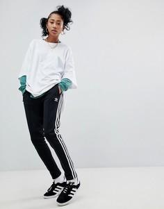 Черные спортивные штаны с тремя полосками по бокам adidas Originals adicolor - Черный