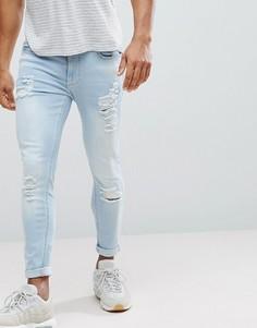 5782ec9753e Черные обтягивающие джинсы с рваной отделкой 11 Degrees - Синий