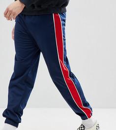 Темно-синие спортивные брюки с красными полосками Reclaimed Vintage Inspired - Темно-синий