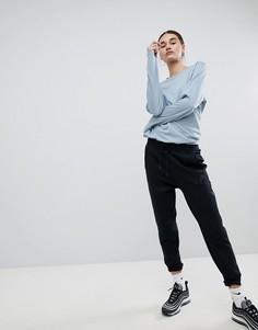 Спортивные штаны из флиса Nike Tech - Черный