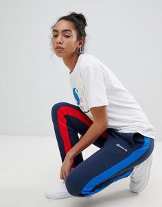 Спортивные штаны с контрастными полосами по бокам Ellesse Heritage - Темно-синий