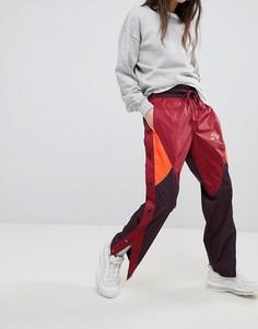 Спортивные штаны в стиле колор блок на кнопках Nike - Мульти