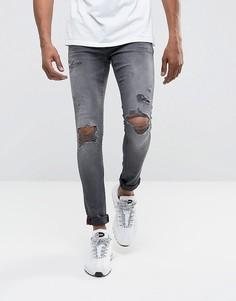 2bfb668fdbd Серые супероблегающие рваные джинсы с напылением DML - Серый