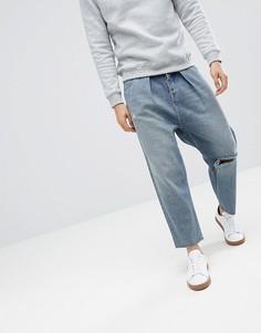 Синие выбеленные джинсы с рваной отделкой ASOS DESIGN - Синий