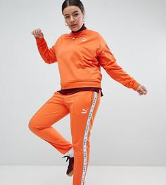 Оранжевые спортивные штаны с полосками по бокам Puma эксклюзивно для ASOS Plus - Оранжевый
