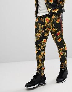 Желтые джоггеры скинни с цветочным принтом Nike 909240-719 - Желтый