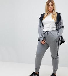 Серые спортивные штаны Nike Plus Tech Fleece - Серый