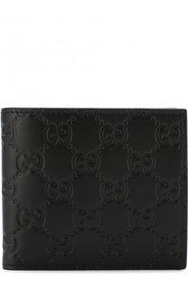 Кожаное портмоне с тиснением Signature Gucci