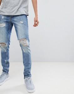 Синие джинсы с рваной отделкой Criminal Damage - Синий