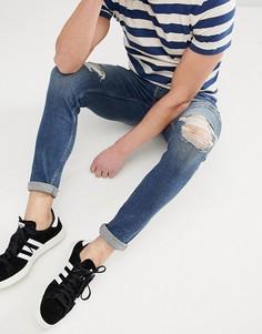 Темные джинсы супероблегающего кроя с рваной отделкой Hollister - Синий