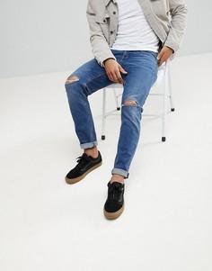 Темные узкие джинсы с рваными коленями ASOS - Синий
