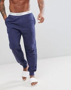 Хлопковые джоггеры классического кроя с манжетами Calvin Klein - Синий