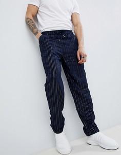 Темно-синие брюки с пайетками и эластичным поясом ASOS DESIGN - Темно-синий
