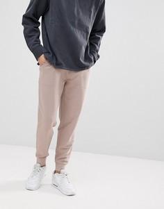 Узкие светло-розовые джоггеры ASOS DESIGN - Розовый