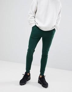Зеленые супероблегающие джоггеры ASOS DESIGN - Зеленый