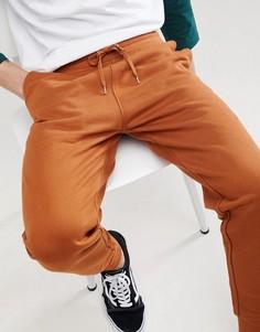 Темно-оранжевые джоггеры узкого кроя ASOS DESIGN - Оранжевый
