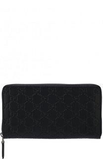 Кожаное портмоне на молнии с тиснением Signature Gucci