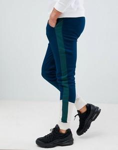 Облегающие джоггеры в стиле колор блок с полосками по бокам ASOS DESIGN - Синий